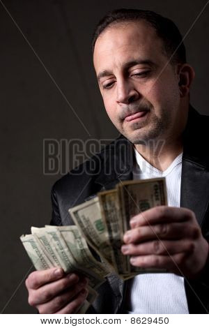 Man Counting Money
