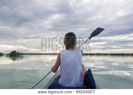 Young Girl Kayaking At Bacalar, Near Cancun, Traveling Mexico. Beautiful Caribbean.