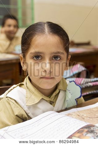 Little Indian girl in class