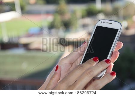 Woman Hands Holding A Smartphone