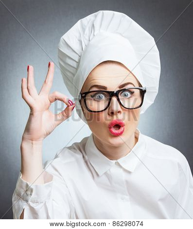 Young Woman Cook Chef Showing Ok, Isolated Over Gray Wall