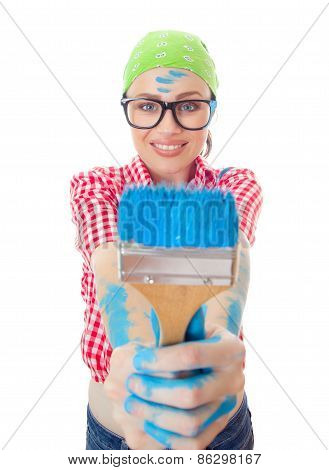 Happy Woman With A Paint Brush Holding It Out At Arms While Painting A Wall, Face In A Focus, Isolat
