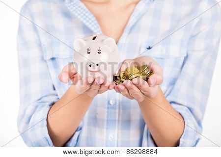 Hands Holding Piggy Bank And Coins As Symbol Of Money Saving And Growth