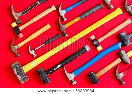Multiple Hammers On A Vivid Red Background