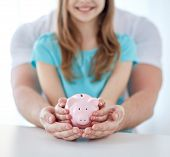 image of holding money  - family - JPG