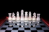 stock photo of chessboard  - Glass chess on a glass stand chessboard - JPG