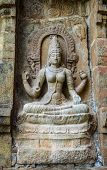 stock photo of tamil  - Hindu God statue on a wall in Hindu Brihadeeswarar Temple Thanjavur Tamil Nadu India - JPG