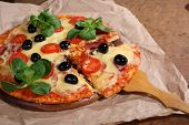 picture of shovel  - Pizza piece on a wooden shovel - JPG