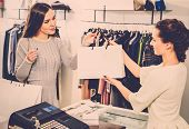 stock photo of showrooms  - Happy customer with shopping bag in fashion showroom - JPG