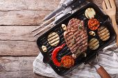 picture of grill  - beef steak grilled with onions and eggplant in the pan grill - JPG