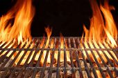 foto of charcoal  - Flame Fire Empty Hot Barbecue Charcoal Grill With Glowing Coals On Black Background - JPG