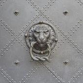 stock photo of lions-head  - Lion head door knocker close - JPG