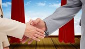 image of curtains stage  - Close up of business people shaking their hands against stage with red curtains - JPG
