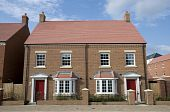 picture of duplex  - Photo of a brand new unoccupied detached red brick built five bedroom house on a modern housing development - JPG