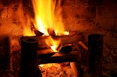 pic of cozy hearth  - Wood fireplace with worn brick and cozy warmth - JPG