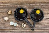 image of quail egg  - Raw eggs in frying pan - JPG