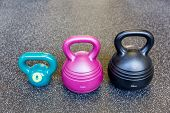 picture of kettlebell  - Kettlebells in row at gym on the background of the floor - JPG