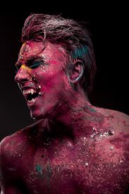 picture of mauri  - A creepy portrait of man with red body art and face art - JPG