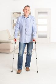 picture of crutch  - Man walking with crutches - JPG