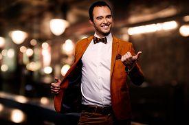 stock photo of fool  - Sharp dressed fashionist fooling around in elite night club  - JPG