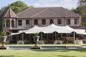 stock photo of mansion  - Home mansion tent celebration dinner party outdoor landscape - JPG