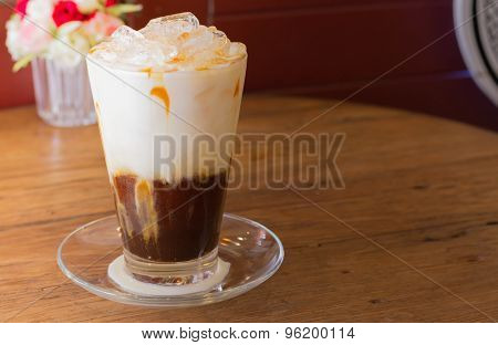 Ice Coffee With Milk On The Wood Desk