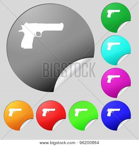 Gun Icon Sign. Set Of Eight Multi Colored Round Buttons, Stickers. Vector