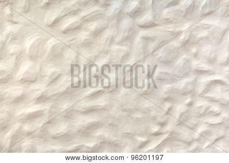 White beige plasterwork with bumpy surface