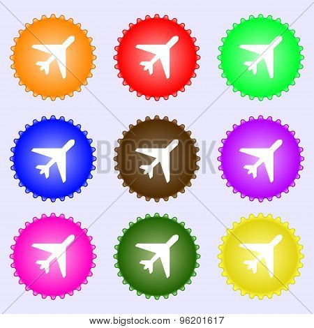 Airplane Icon Sign. A Set Of Nine Different Colored Labels. Vector