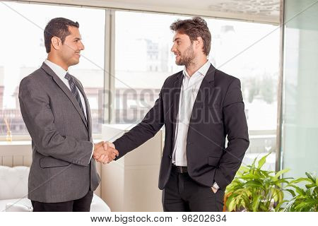 Handsome young business partners build a consensus on meeting