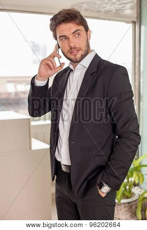 Cheerful young man is scheduling a meeting with his client
