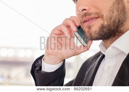 Successful young businessman is arranging an appointment with his client