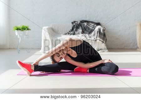 Fit woman high body flexibility stretching her leg and back to warm up doing aerobics gymnastics exe