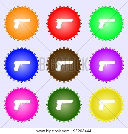 Gun Icon Sign. A Set Of Nine Different Colored Labels. Vector