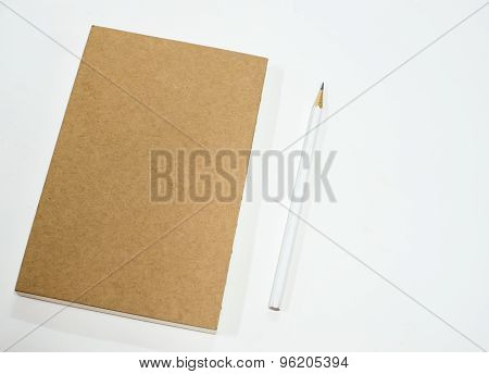 Note Book With Pencil On White Background