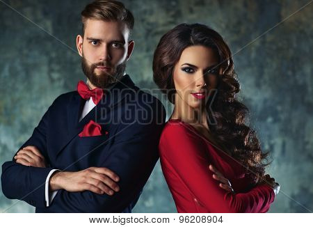 Young elegant couple in evening dress portrait. Standing shoulder to shoulder.