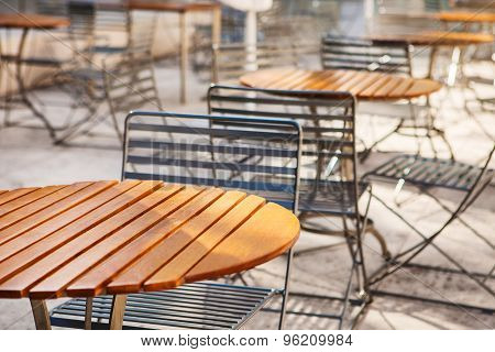 Close up of round wooden tables and chairs
