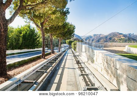 Funicular rails against backdrop of the mountains In Los Angeles, USA. California landscape in sunny