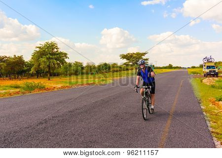 Man On The Bicycle In Africa.