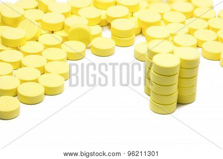 Many Yellow Medicine On The White Background
