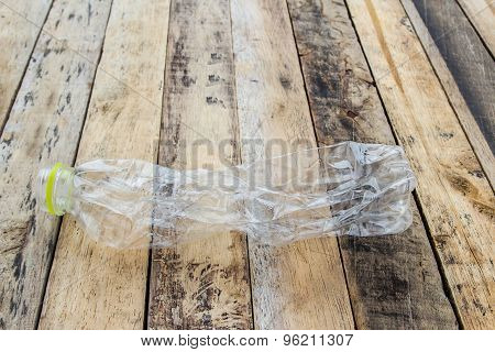 Plastic Water Bottles For Recycle On The Wooden Table