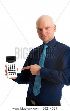 Business Man In Blue Shirt Pointing To A Pocket Calculator