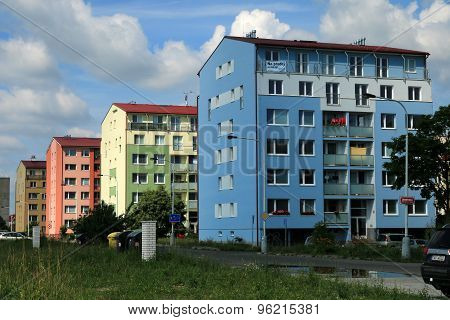Block Of Flats In Blue, Green And Orange Color