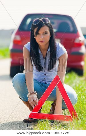 Woman With A Warning Triangle In Case Of Breakdown