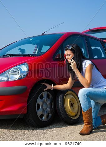 Woman With A Flat Tire In Car