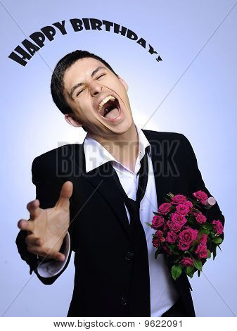 Handsome Romantic Young Man Holding Rose Flower. Gray Background. Happy Birthsday Sighn