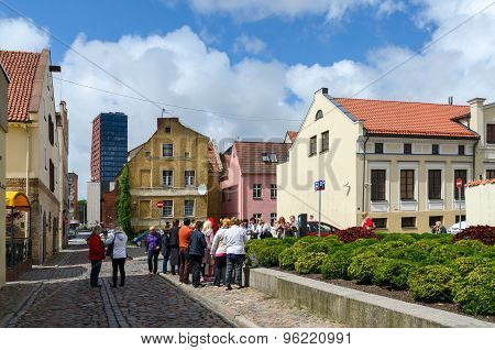 Tourists See Sights In Street Of Old Town In Klaipeda