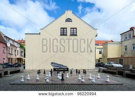 Chess Board With Figures On Street In Old Town Of Klaipeda, Lithuania