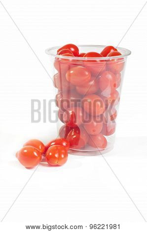 Red cherry tomatoes in plastic packaging