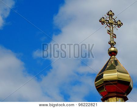 dome with a cross of the Christian church against the sky